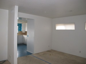 Kitchen has moved into the space in the forefront and the supporting wall is now gone